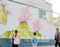 手绘山水墙画 扮美江畔农家院落